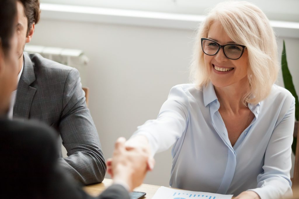 Recruitment specialist shaking hands with person who is ready to recruit staff